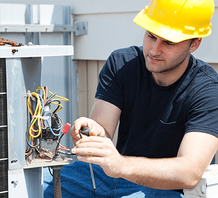 Image of an engineer engaged in air conditioner repair
