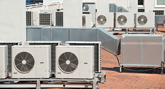 Image of a number of rooftop air conditioning units and ductwork